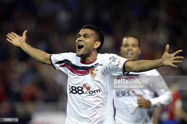 Sevilla's Brazilian Daniel Alves Da Silva celebrates scoring against Atletico de Madrid during their Spanish league football match at the Sanchez...
