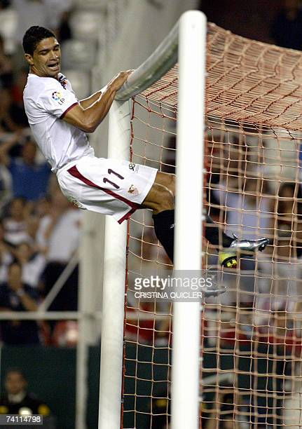 Sevilla's Brazilian Renato Dirnei Florencio jumps onto the crossbar during a King's Cup football match against Deportivo la Coruna at the Sanchez...