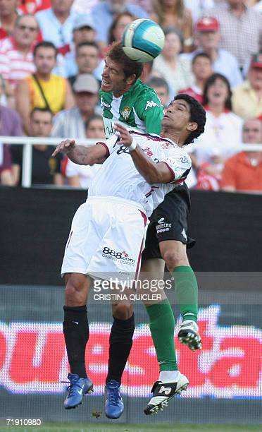 Sevilla's Brazilian Renato Dirnei jumps for a header with Betis's Romero during a derby football match at the Sanchez Pizjuan stadium in Sevilla 17...