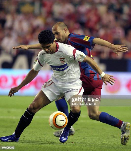 Sevilla's Brazilian Renato Dirnei vies with Barcelona's Gabri Garcia during a Spanish league football match at the Sanchez Pizjuan stadium in Sevilla...