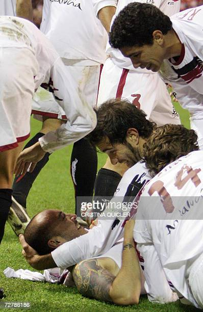 Sevilla's Uruguayan Ernesto Javier Chevanton celebrates with teammates after scoing the winning goal against Real Madrid during a Spanish league...