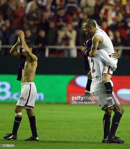 Sevilla's Uruguayan Ernesto Javier Chevanton celebrates with Freddie Kanoute after beating Real Madrid during a Spanish league football match at the...