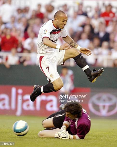 Sevilla's Uruguayan Ernesto Javier Chevanton jumps over Athletic Bilbao's Lafuente during a Spanish league football match at the Sanchez Pizjuan...