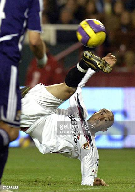 Sevilla's Uruguayan Ernesto Javier Chevanton scores with an acrobatic shot against Real Madrid during a Spanish league football match at the Sanchez...