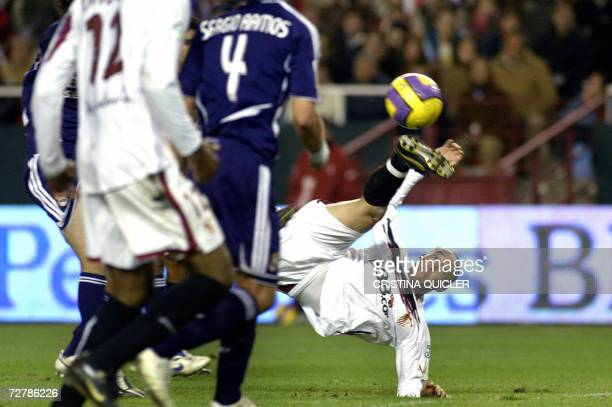 Sevilla's Uruguayan Ernesto Javier Chevanton acrobatically shoots and scores the winner against Real Madrid during a Spanish league football match at...