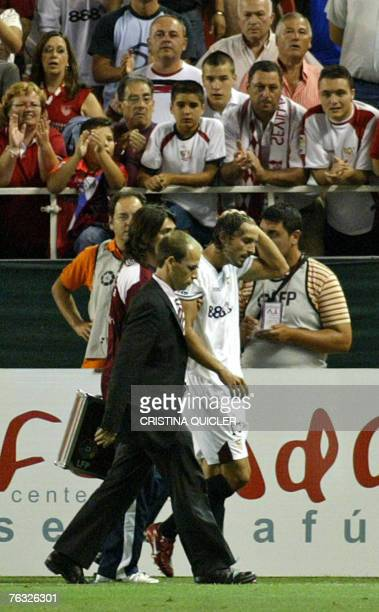 Sevilla's Antonio Puerta leaves the pitch after being tackled seriously by a Getafe football player during their Spanish league football match at the...