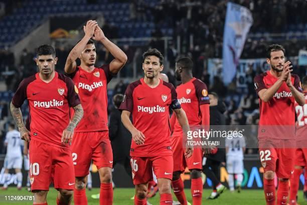 Sevilla's Argentine midfielder Ever Banega Sevilla's Portuguese forward Andre Silva Sevilla's Spanish midfielder Jesus Navas and Sevilla's Argentine...