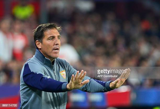 Sevilla's Argentinian coach Eduardo Berizzo gives instructions to players during the UEFA Champions League group E football match between Sevilla and...