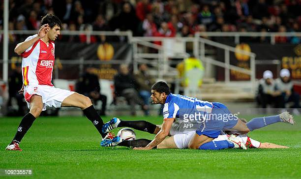 Sevilla's Argentinian defender Federico Fazio and Rakitic vies with FC Porto's forward from Brazil Givanildo de Souza Hulk during the UEFA Europa...
