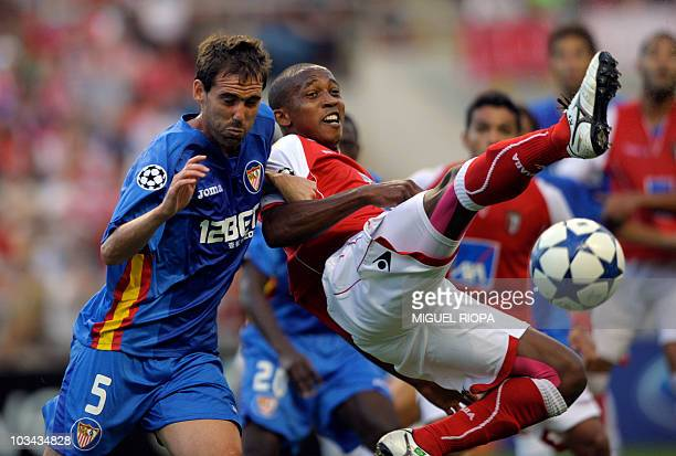 Sevilla's Argentinian defender Fernando Navarro vies with SC Braga's forward from Brazil Paulo Cesar during their UEFA Champions League play off...
