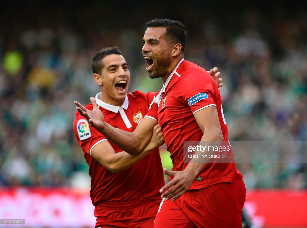 Sevilla's Argentinian defender Gabriel Mercado (R) celebrates after scoring a goal with Sevilla's French forward Wissam Ben Yedder (L) during the Spanish league football match Real Betis vs Sevilla FC at the Benito Villamarin stadium in Sevilla on February 25, 2017. / AFP / CRISTINA