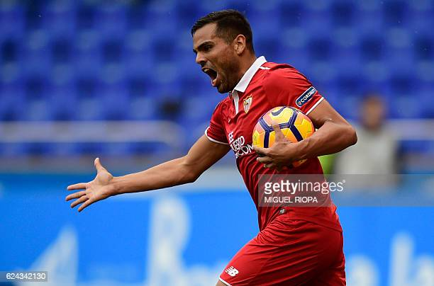 Sevilla's Argentinian defender Gabriel Mercado celebrates his teammate forward Vitolo's goal during the Spanish league football match between RC...