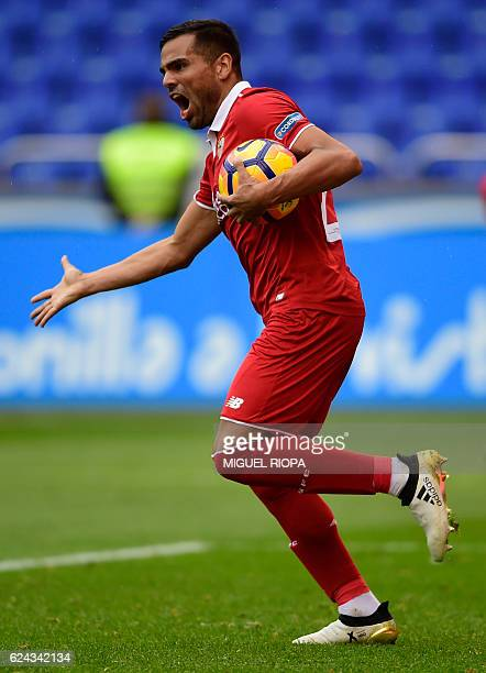 Sevilla's Argentinian defender Gabriel Mercado celebrates his teammate forward Vitolo's goal during the Spanish league football match between RC...