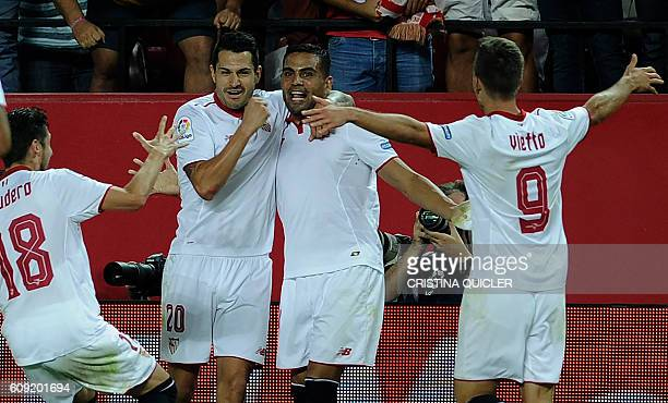 Sevilla's Argentinian defender Gabriel Mercado celebrates with Sevilla's midfielder Vitolo and teammates after scoring during the Spanish league...
