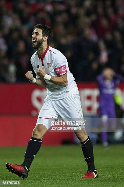 Sevilla's Argentinian defender Nicolas Pareja celebrates their 21 victory at the end of the Spanish league football match Sevilla FC vs Real Madrid...
