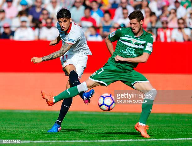 Sevilla's Argentinian defender Nicolas Pareja vies with Leganes' Argentinian midfielder Alexander Szymanowski during the Spanish league football...
