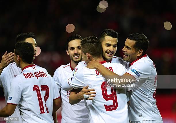 Sevilla's Argentinian forward Luciano Vietto celebrates a goal with teammates during the Spanish league football match Sevilla FC vs Malaga CF at the...