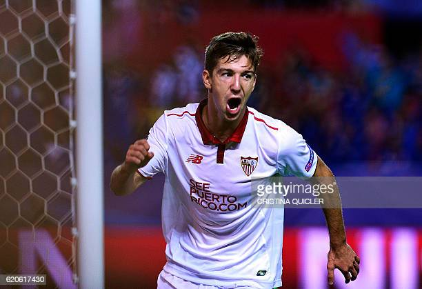 Sevilla's Argentinian forward Luciano Vietto celebrates after scoring during the UEFA Champions League Group H football match Sevilla FC vs GNK...