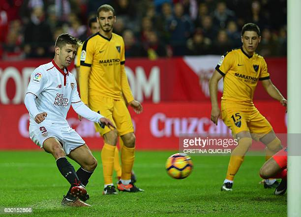 Sevilla's Argentinian forward Luciano Vietto scores a goal during the Spanish league football match Sevilla FC vs Malaga CF at the Ramon Sanchez...