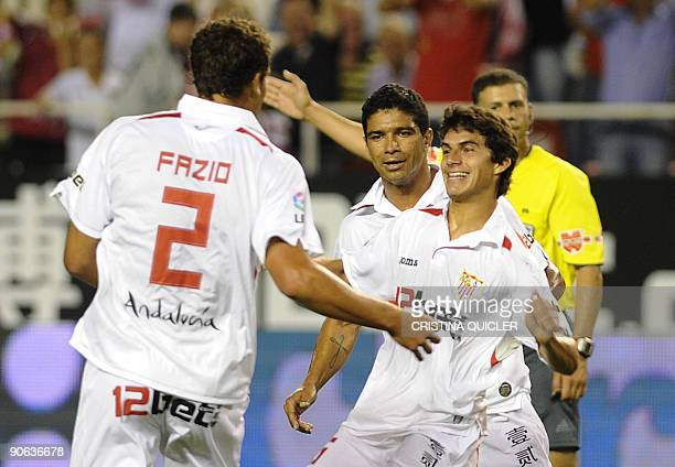 Sevilla's Argentinian midfielder Diego Perotti celebrates after scoring with Sevilla's Argentinian defender Federico Fazio and Sevilla's Brazilian...