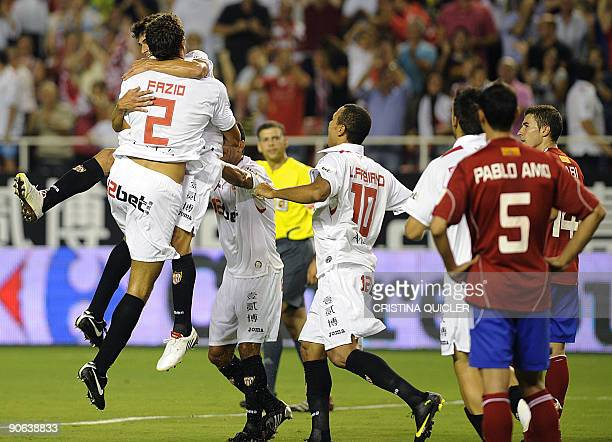 Sevilla's Argentinian midfielder Diego Perotti celebrates after scoring with his teammates Argentinian defender Federico Fazio Brazilian midfielder...