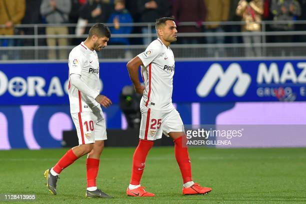 Sevilla's Argentinian midfielder Ever Banega and Argentinian defender Gabriel Mercado walk off the pitch at the end of the Spanish league football...