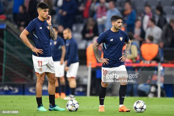 Sevilla's Argentinian midfielder Ever Banega and Sevilla's Argentinian midfielder Joaquin Correa warm up on the ball prior to the UEFA Champions...