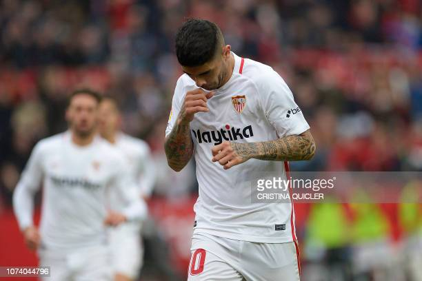 Sevilla's Argentinian midfielder Ever Banega celebrates after scoring a goal during the Spanish League football match between Sevilla and Girona at...