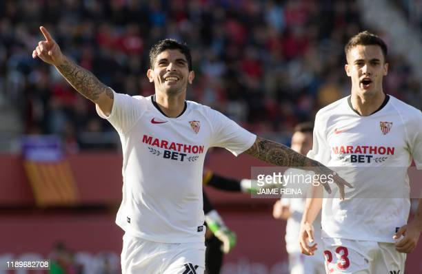 Sevilla's Argentinian midfielder Ever Banega celebrates after scoring a goal during the Spanish league football match between RCD Mallorca and...