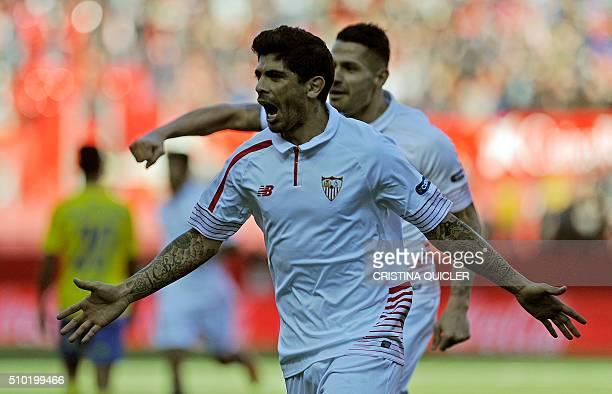 Sevilla's Argentinian midfielder Ever Banega celebrates after scoring during the Spanish league football match FC Sevilla vs UD Las Palmas at the...