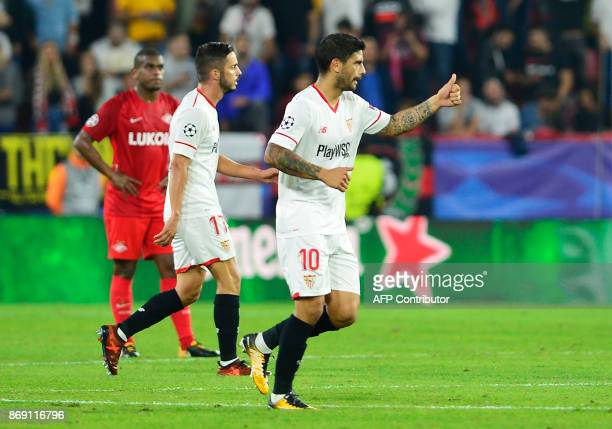 Sevilla's Argentinian midfielder Ever Banega celebrates after scoring a goal during the UEFA Champions League group E football match between Sevilla...