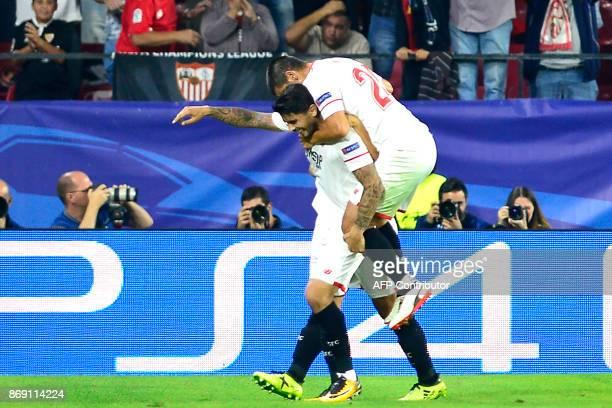 Sevilla's Argentinian midfielder Ever Banega celebrates with Sevilla's Argentinian defender Gabriel Mercado after scoring a goal during the UEFA...