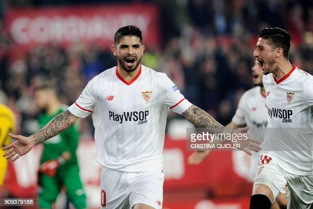 Sevilla's Argentinian midfielder Ever Banega celebrates with Sevilla's Spanish defender Sergio Escudero after scoring a goal during the Spanish 'Copa...
