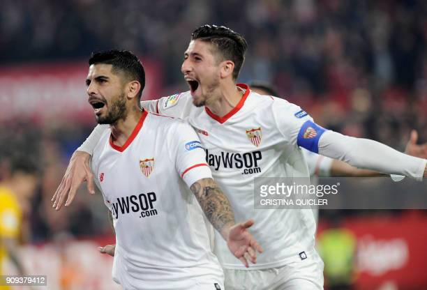 Sevilla's Argentinian midfielder Ever Banega celebrates with Sevilla's Spanish defender Sergio Escudero after scoring a goal during the Spanish 'Copa...