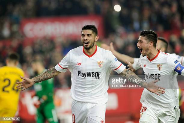 Sevilla's Argentinian midfielder Ever Banega celebrates with teammates after scoring a goal during the Spanish 'Copa del Rey' quarter-final second...