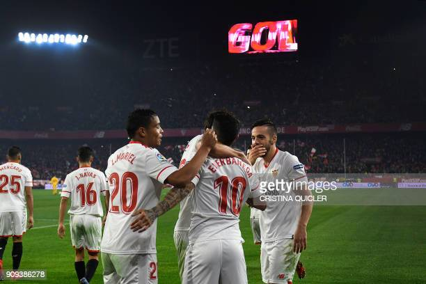 Sevilla's Argentinian midfielder Ever Banega celebrates with teammates after scoring a goal during the Spanish 'Copa del Rey' quarterfinal second leg...