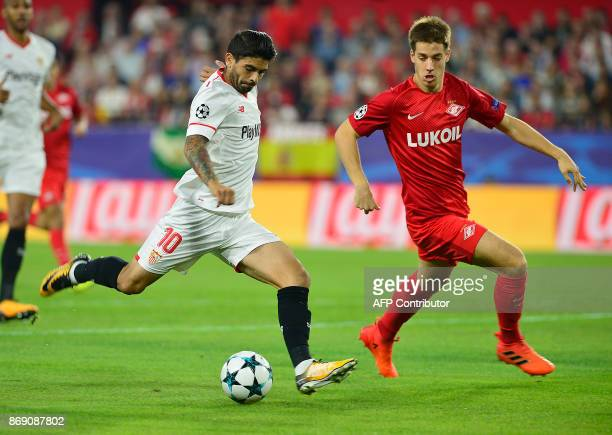 Sevilla's Argentinian midfielder Ever Banega challenges Spartak Moscow's Croatian midfielder Mario Pasalic during the UEFA Champions League group E...
