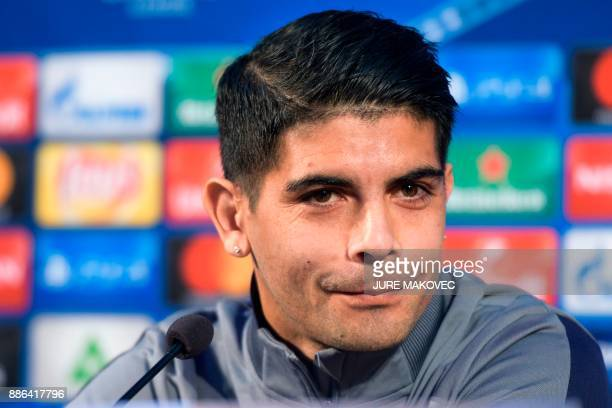 Sevilla's Argentinian midfielder Ever Banega holds a press conference on the eve of the UEFA Champions League Group E football match between NK...