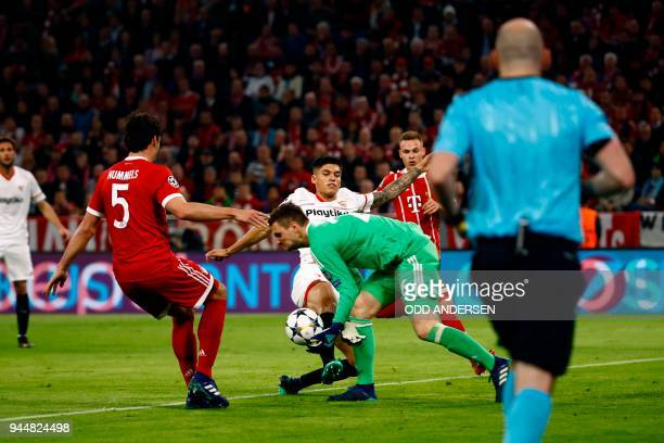 Sevilla's Argentinian midfielder Ever Banega kicks the ball in front of Bayern Munich's German goalkeeper Sven Ulreich during the UEFA Champions...