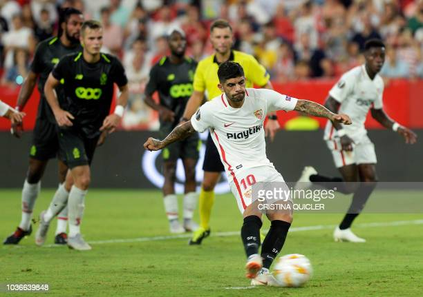 Sevilla's Argentinian midfielder Ever Banega shoots a penalty kick to score a goal during the UEFA Europa League group J football match between...