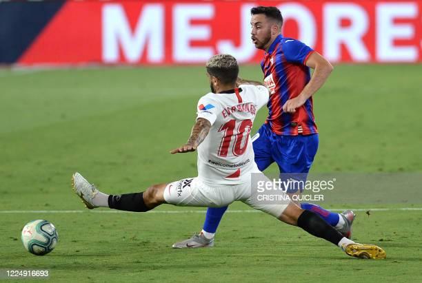 Sevilla's Argentinian midfielder Ever Banega vies with Eibar's Spanish midfielder Edu Exposito during the Spanish League football match between...