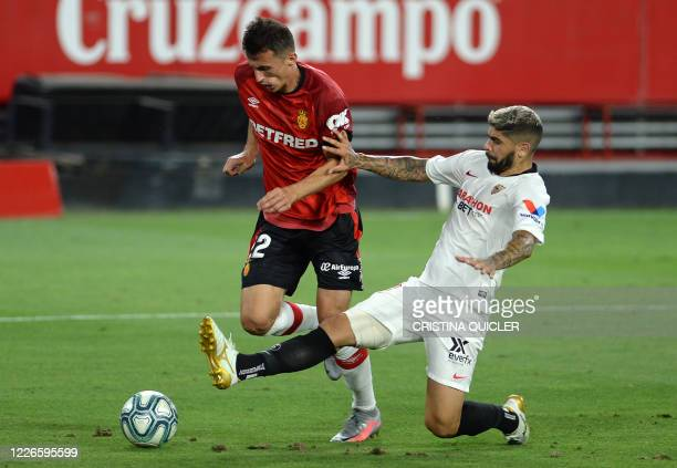 Sevilla's Argentinian midfielder Ever Banega vies with Real Mallorca's Croatian forward Ante Budimir during the Spanish league football match between...