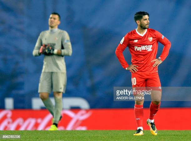 Sevilla's Argentinian midfielder Ever Banega walks on the field after Real Scoiedad's second goal during the Spanish league football match Real...
