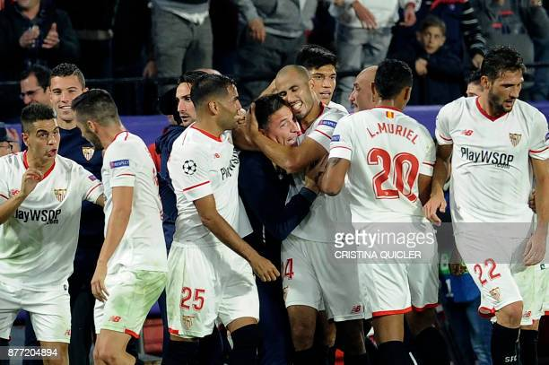 Sevilla's Argentinian midfielder Guido Pizarro celebrates with Sevilla's Argentinian coach Eduardo Berizzo after scoring a goal on November 21 2017...