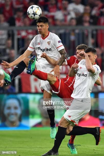 Sevilla's Argentinian midfielder Joaquin Correa and Sevilla's Italian midfielder Franco Vazquez vie for the ball with Bayern Munich's German forward...