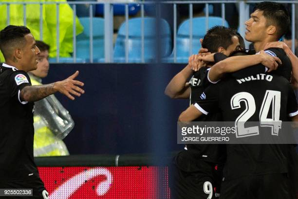 Sevilla's Argentinian midfielder Joaquin Correa celebrates a goal with teammates during the Spanish league football match Malaga CF against Sevilla...