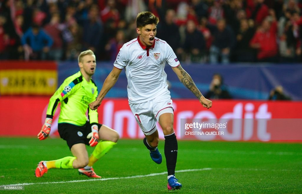 Sevilla's Argentinian midfielder Joaquin Correa (R) celebrates after scoring a goal during the UEFA Champions League round of 16 second leg football match Sevilla FC vs Leicester City at the Ramon Sanchez Pizjuan stadium in Sevilla on February 22, 2017. / AFP / CRISTINA