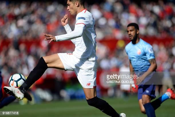 Sevilla's Argentinian midfielder Joaquin Correa kicks the ball to score a goal during the Spanish league football match between Sevilla FC and Girona...