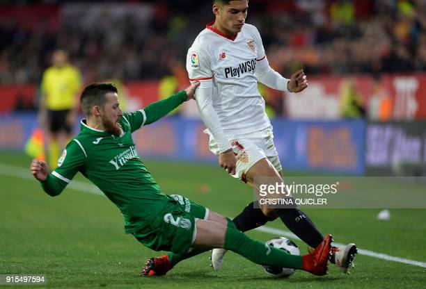 Sevilla's Argentinian midfielder Joaquin Correa vies for the ball with Leganes's defender Tito during the Spanish 'Copa del Rey' second leg semifinal...