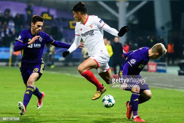 Sevilla's Argentinian midfielder Joaquin Correa vies with Maribor's Slovenian forward Gregor Bajde and Slovenian defender Martin Milec during the...